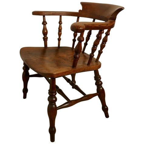 Captains Chair And Desk by 19th Century Elm And Ash Smokers Bow Captains Chair