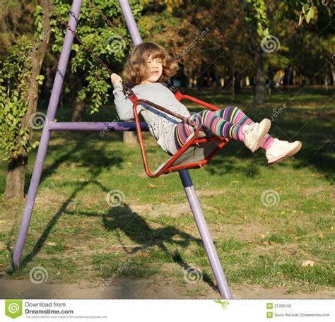 little girl on swing little girl on swing stock photo image 27436100