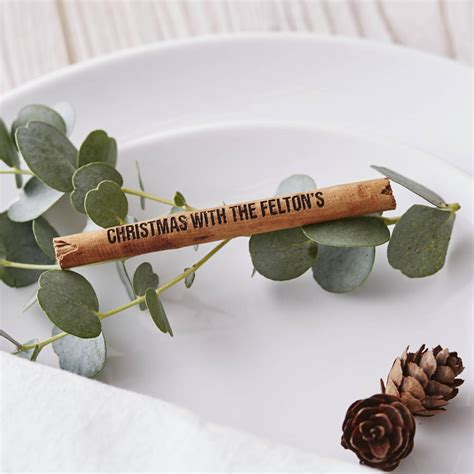 cinnamon stick personalised christmas table decorations by