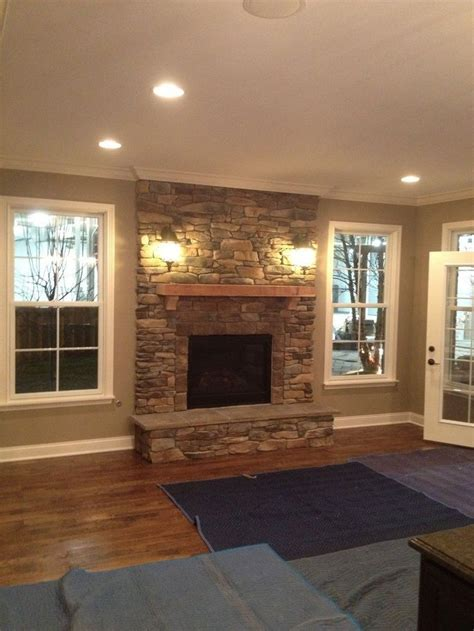 my place family room the 25 best fireplace between windows ideas on fireplace windows fireplace ideas