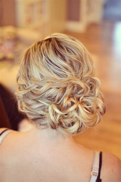 wedding hair bun on the side wedding hair side bun curls plaits bridesmaid guest