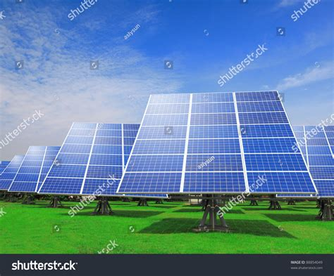 solar panel with green grass and beautiful blue sky stock