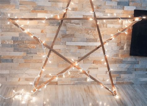 remodelaholic diy large rustic wood star  lights