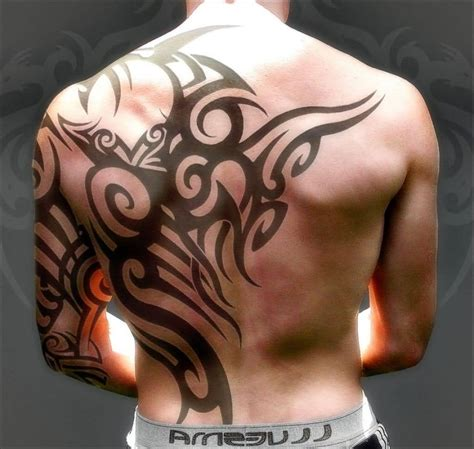 tribal tattoos on the back creative grey skulls with eye and tribal design on