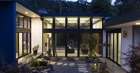 klopf architecture replaced a dilapidated 1940s house with modern atrium house klopf architecture 171 inhabitat green