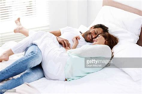 romantic pictures of couples in bed conversation couple stock photos and pictures getty images