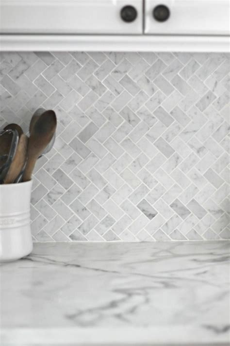 gray and white herringbone backsplash tile style