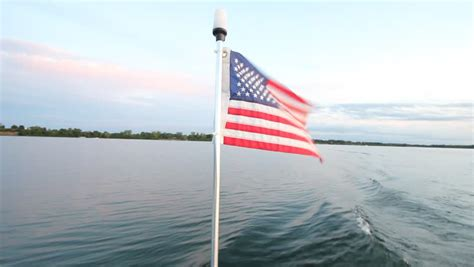 american flag for boat american flag on boat navigating on sea stock footage
