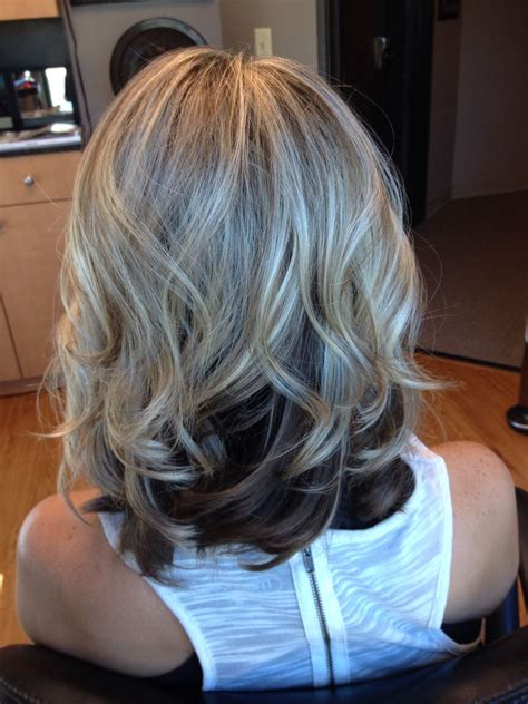 lowlighting the hair under the top layer blonde top dark underneath hair by melissa lobaito