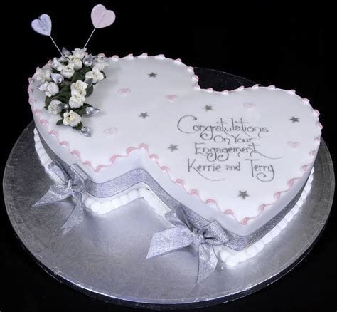 Engagement Cake. I like the two heart theme, and in blue