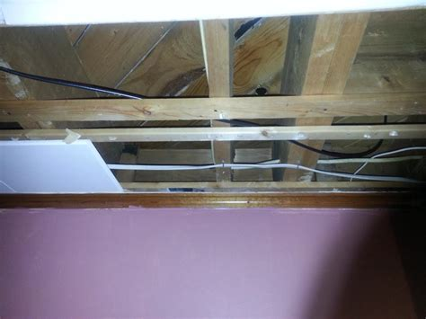 electrical is it okay to staple romex to a floor joist