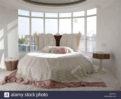 bedroom with round bed luxurious bedroom with a round bed in a loft in dubai