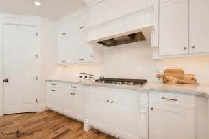 Kitchen Backsplash Photos White Cabinets white on white kitchen features white shaker cabinets accented with