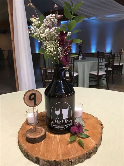 Growlers used for a table centerpiece . Brewery wedding