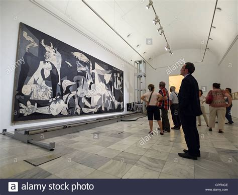 picasso paintings in reina sofia visitors looking at quot guernica quot painting by pablo picasso