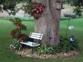 backyard landscaping around large trees flowers around a