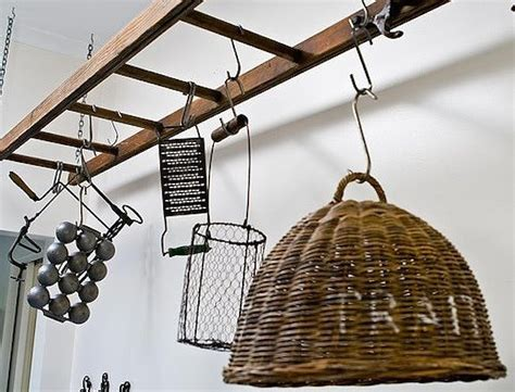 simply hang an old ladder horizontally from the ceiling to