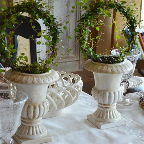 Elegant table decoration with white tableware rattan placemats and green table centerpieces