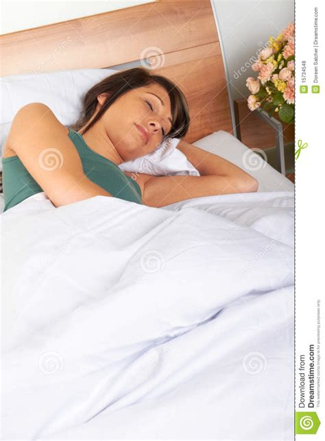 woman sleeping in bed young woman sleeping in bed royalty free stock photos