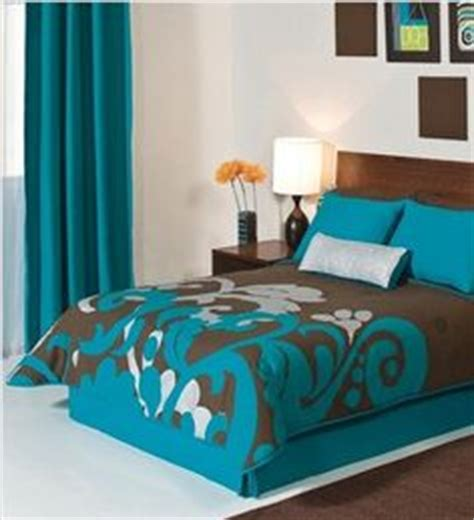 turquoise and brown bedding on brown bedding