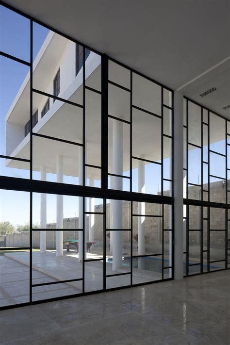 contemporary curtain wall architecture modern hacienda style home built on pillars modern house