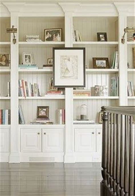 idea for ready made bookcases just add wood moldings to