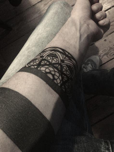 tattoo on black arm black pattern tattoo