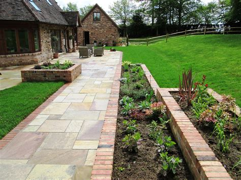 Backyard Trellis Designs by Garden With Reclaimed Brick Planters And Indian Sandstone