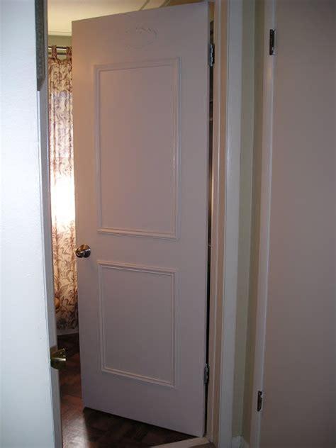 Add Moulding To Door by How To Faux Panel A Door Update Your Flat Paneled Door