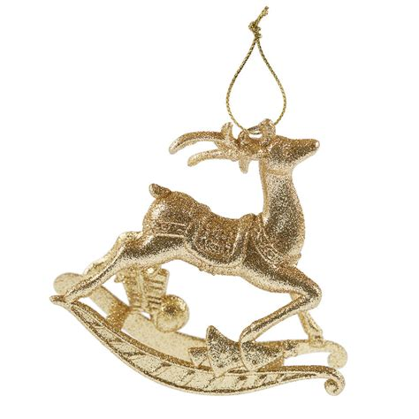 gold reindeer rocking horse decoration by the christmas