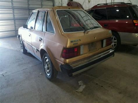 1fabp13h3ew295603 1984 gold ford escort l on sale in nv reno lot 35495047