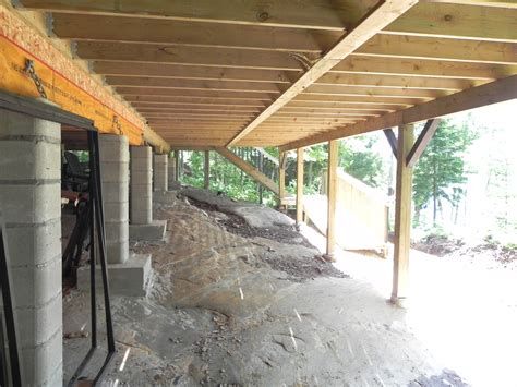 mcdougall cottage attached deck piers on rock