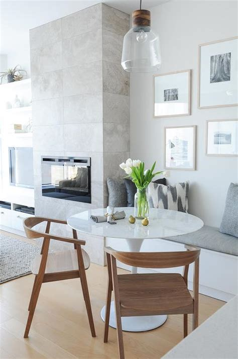 built in bench dining table dining room modern with wall dining bench next to fireplace transitional dining room