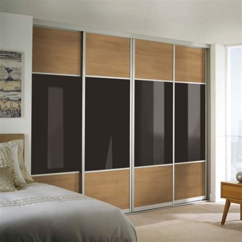 Wardrobe With Sliding Doors Uk by Black Glass Sliding Wardrobe Doors Sliding Wardrobes Uk
