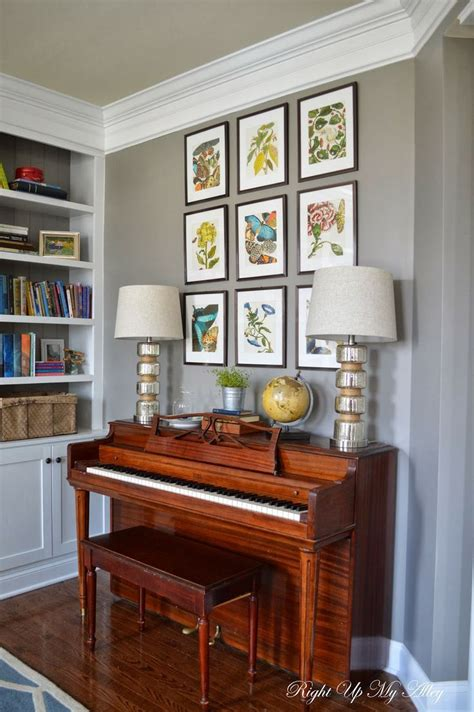 living room with piano melody loves the idea of an upright piano in our living