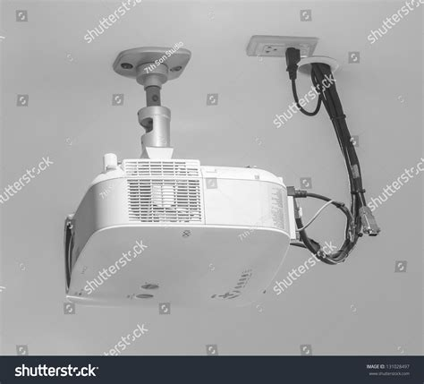 projector hang on ceiling in meeting room stock photo