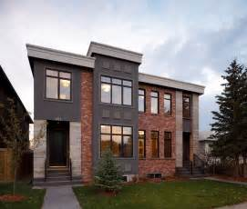 Modern Brick Homes combination of red brick and gray stucco in the exterior house