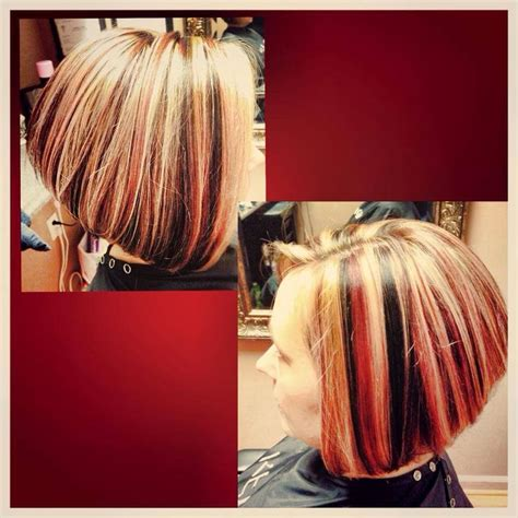 sexy bob haircut with chunky red highlites multi dimensional color red black and blonde highlight