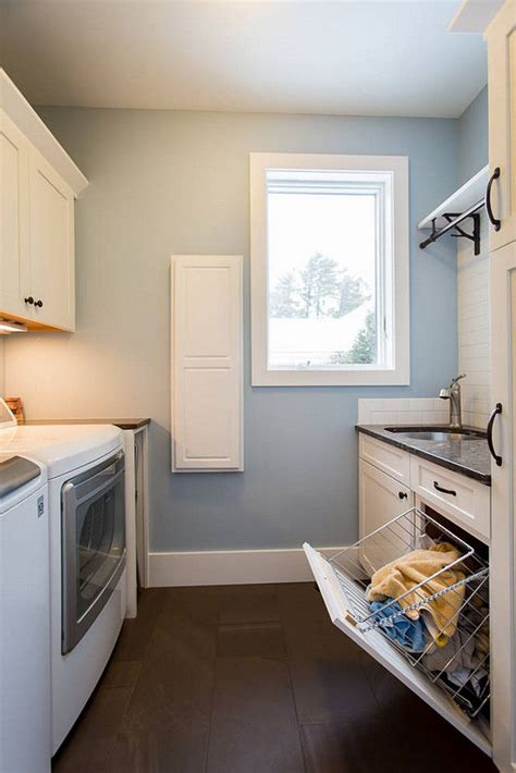 paint colors for laundry room 25 best ideas about blue laundry rooms on hanging racks blue storage cabinets and