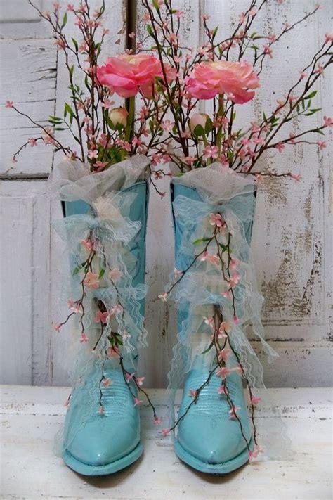 decorative floral arrangement cowboy boots aqua blue pink