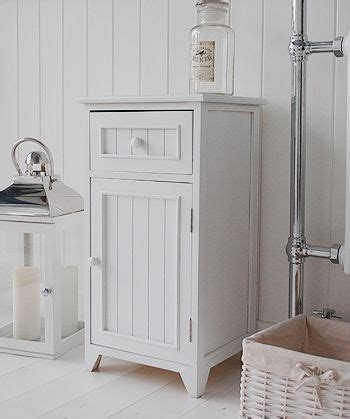 Free Standing Bathroom Storage Furniture A Crisp White Freestanding Bathroom Storage Furniture A Narrow Bathroom Cabinet With One Drawer