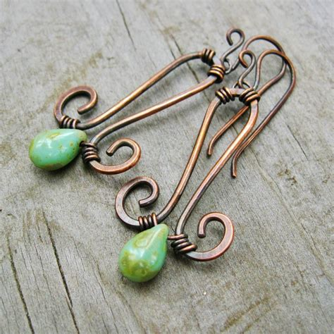 hammered copper wire wrapped jewelry hammered copper and wire wrapped picasso glass drops