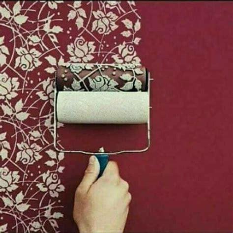 roll cat motif  dinding ruangan cukup pakai cat