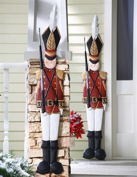 2 metal tin soldiers nutcracker red coat christmas holiday
