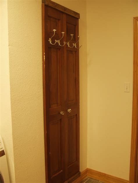 re purposed doors made into coat rack for the home