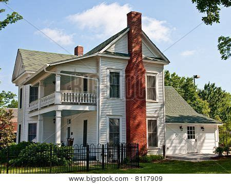 two story farmhouse old white two story farmhouse red image photo bigstock