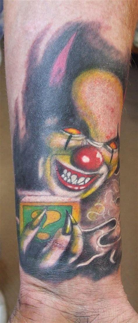 new school clown tattoo new school style colored evil clown tattoo on arm