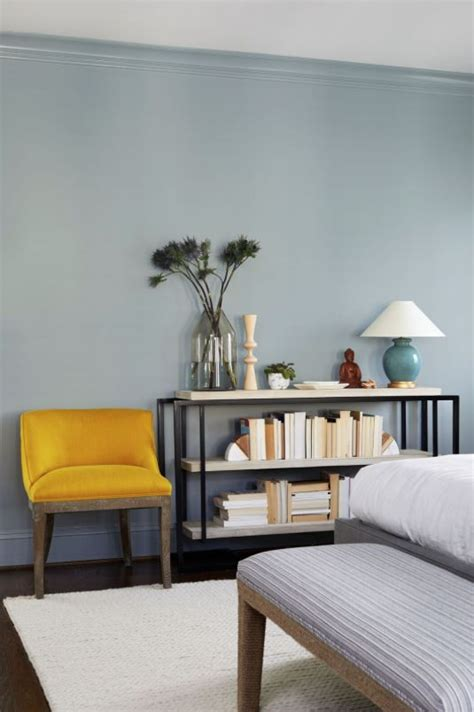 light blue walls  bright yellow statement chair