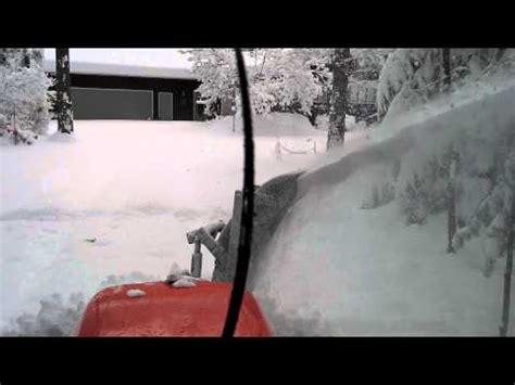 christmas l post with blowing snow kubota l5740 front mount snowblower with 17 of snow
