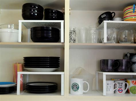 kitchen storage solutions cupboard organizer raised